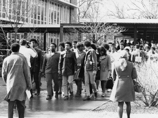 Group of students walking through OSU campus